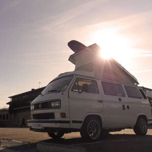 VW T25 Westfalia campervan for hire london pop top roof up surfboard on top
