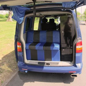 VW campervan hire London VW T5 campervan rear rock and roll bed