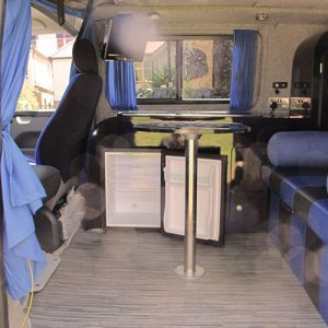 VW campervan hire London VW T5 campervan rear with fridge and table