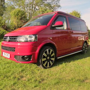 VW campervan hire London VW T5 campervan red front pop top roof down 2
