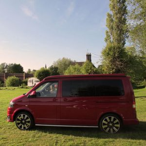 VW campervan hire London VW T5 campervan red front pop top roof down