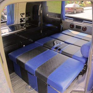 VW campervan hire London VW T5 campervan rock and roll bed