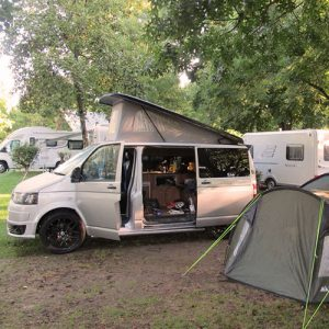 VW campervan hire London VW T5 campervan silver pop top with roof up camping