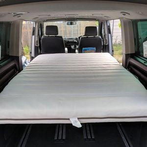 VW Campervan hire London Premium silver Carl bed down inside